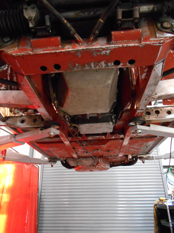 Aston Martin DB6 Volante Restoration -underside devoid of underseal and ready for masking