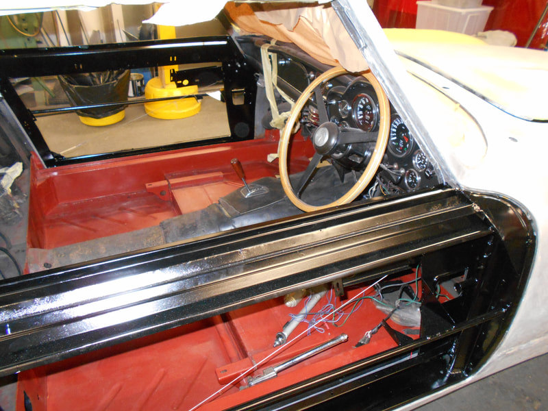 Aston Martin DB6 Volante Restoration -both door frame repairs completed and in epoxy primer