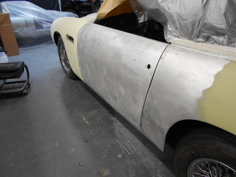 Aston Martin DB6 Volante Restoration -left hand door skin fitted